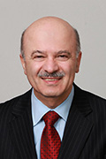 Headshot of Reza Moridi.