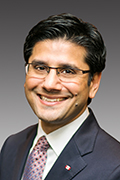 Headshot of Yasir Naqvi.