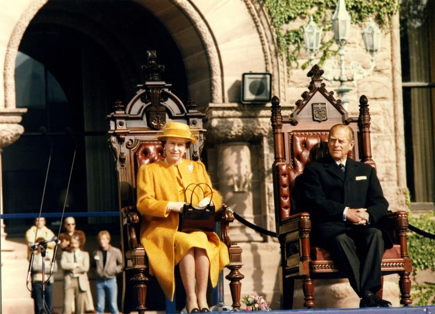 Picture of The Duke of Edinburgh with Her Majesty Queen Elizabeth II in front of Ontario's Legislative Building, 1984