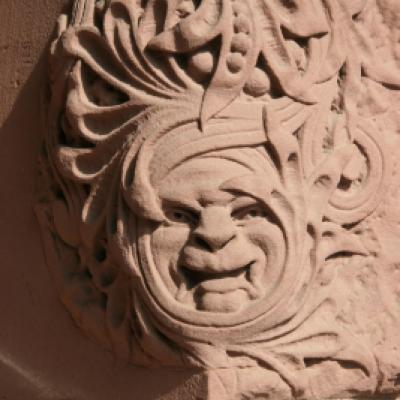 Face carved into the sandstone by the south entrance of the Legislative Building.