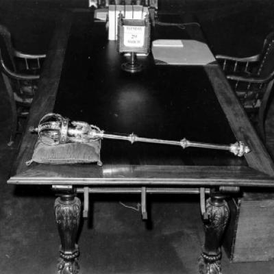 The Legislative Mace laying on the Clerk's Table in the Chamber, circa 1960.